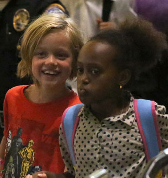 Shiloh and Zahara Jolie-Pitt were spotted holding hands at LAX.