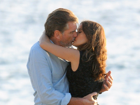 "Pierce Brosnan and Salma Hayek shared a smooch on the set of ""How to Make Love…"
