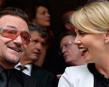 Bono and Charlize Theron attended the memorial service for South Africa former…