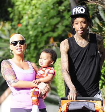 Amber Rose and rapper hubby Wiz Khalifa took son Sebastian for a walk in L.A.