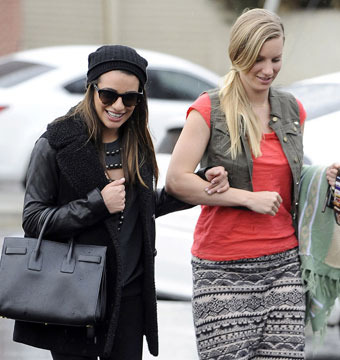 "Lea Michele was spotted out with ""Glee"" co-star Heather Morris on a rainy day…"