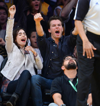 Lily Collins and boyfriend Thomas Cocquerel sat courtside at the Lakers game…