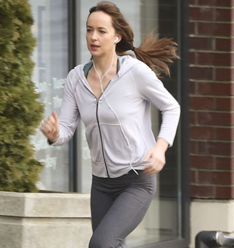"Dakota Johnson went for a run on the set of ""Fifty Shades of Grey"" in Vancouver…"