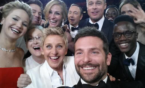 Photobomb! Who Is the Mystery Man in Ellen's Star-Studded Oscar…