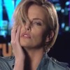 Charlize Theron Masters the 'Model Face' in 'SNL' Promos