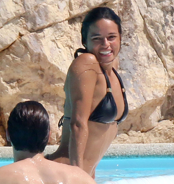Michelle Rodriguez went for a swim with Peter Brant II at the Eden Roc Hotel in…