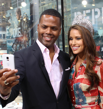 """Extra's"" AJ Calloway and newly crowned Miss USA Nina Sanchez snapped a selfie…"