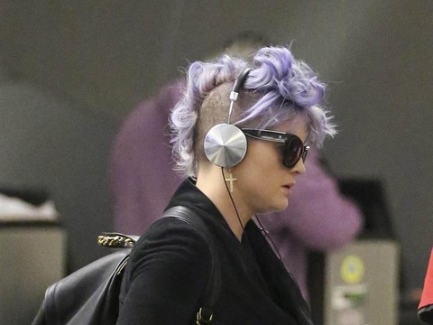 Kelly Osbourne touched down at LAX after a flight from London.
