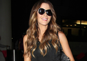 Kate Beckinsale was all smiles as she arrived in L.A. from London.