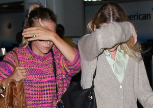 Mary-Kate and Ashley Olsen hid their faces as they arrived to LAX from NYC.