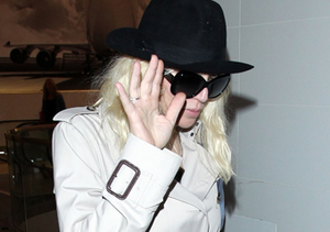 A camera shy Courtney Love hopped a flight from L.A. to NYC.