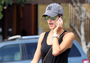 Model Alessandra Ambrosio talking away on her cell phone while shopping at the…