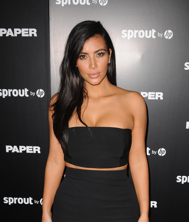 Find Out Why Kim Kardashian Doesn't Like to Smile Too Much