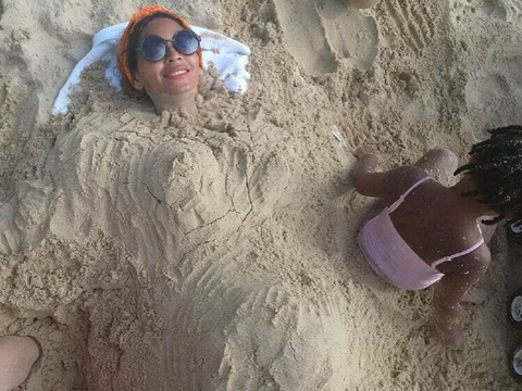 Beyoncé Sparks Pregnancy Rumors with Beach Bump Pic