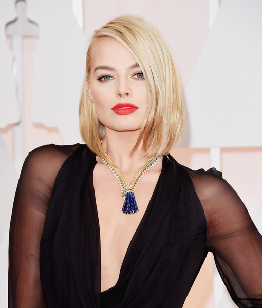 Taking the Plunge! Margot Robbie Takes a Risk in Deep V-Neck Gown