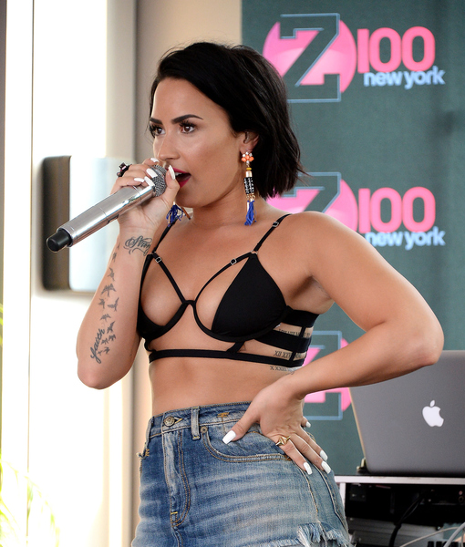 Demi Lovato's Summer Stripdown! Barely There Top, Daisy Dukes, and Crazy Gladiator Heels!