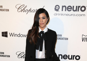 Kourtney Kardashian Soldiers on Following Split