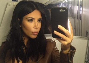 Extra Scoop: Kim Kardashian Snaps Pics of New Haircut in Airplane Bathroom
