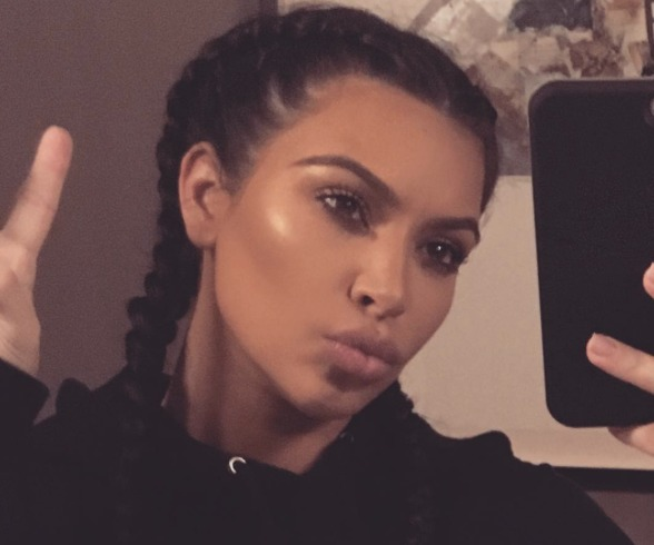 Kim Kardashian 'Hands Out' First Pic of Saint West