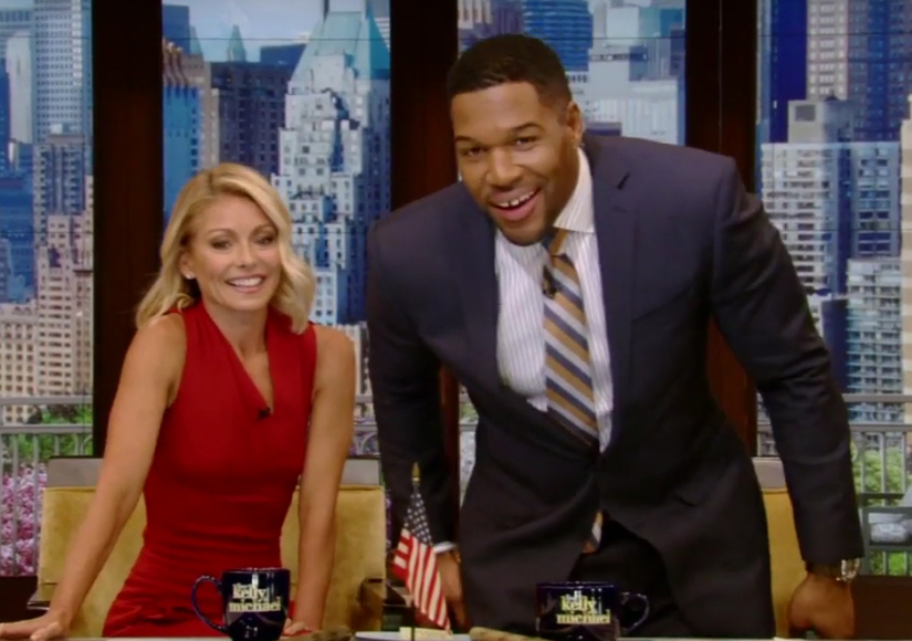 Kelly Ripa & Michael Strahan Hold Hands on 'Live!': 'Our Long National Nightmare Is Over'
