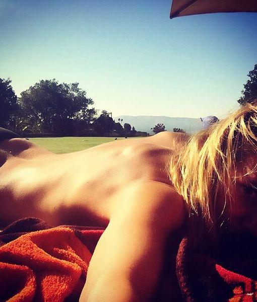 Heidi Klum & Elizabeth Hurley Go Topless to Celebrate the Summer Season