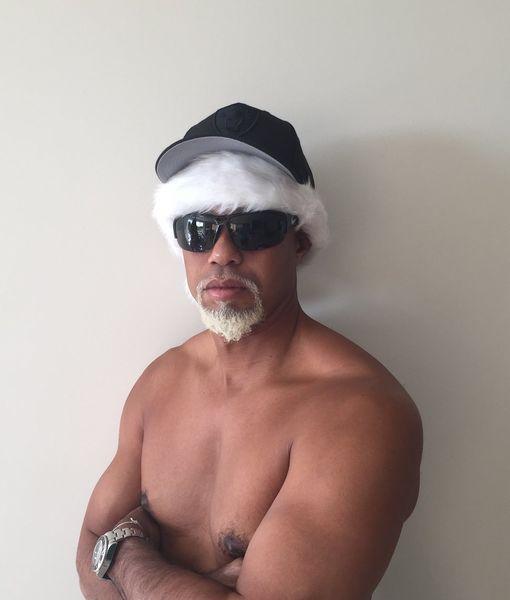 Tiger Woods Goes Shirtless as 'Mac Daddy Santa'