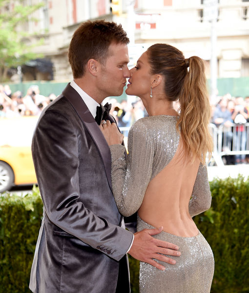 PDA Alert! Gisele Bündchen & Tom Brady Smooch on the Met Gala Red Carpet