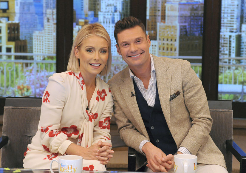 Kelly Ripa Wears Bright Red Pumps to Reveal Her New Co-Host