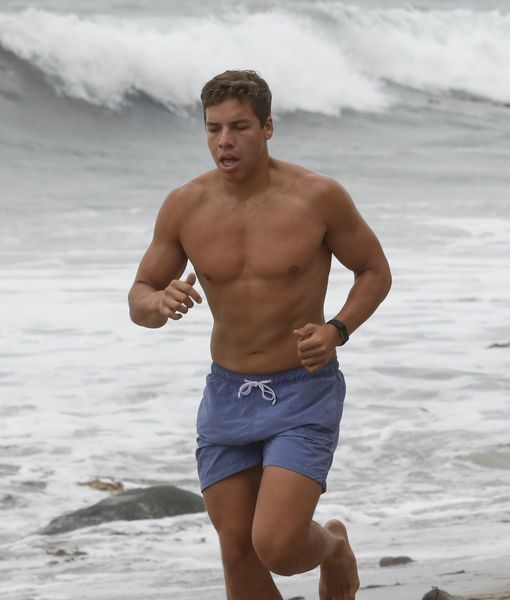 Arnold Schwarzenegger's Look-Alike Son Joseph Baena Goes Jogging on the Beach
