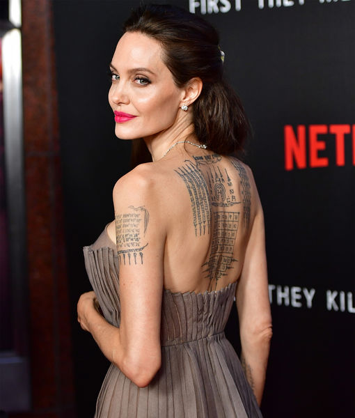 Angelina Jolie Shows Off Massive Back Tattoo While Making Rare Appearance with Dad