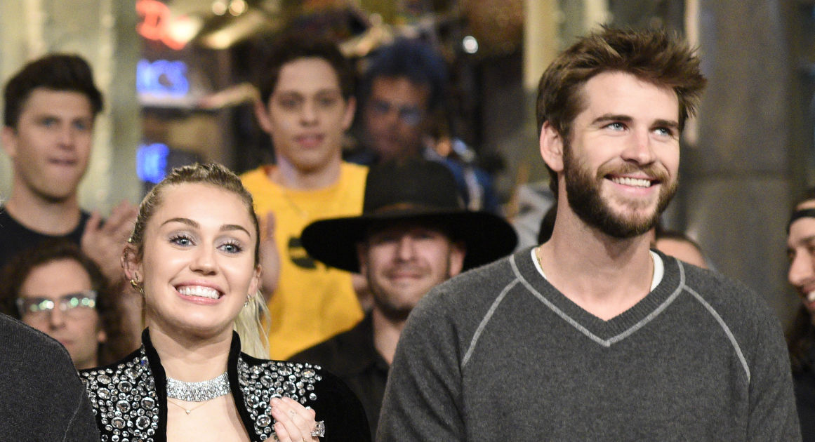 731c679c9049c1 Liam Hemsworth Surprises at  SNL  Alongside Fiancée Miley Cyrus ...