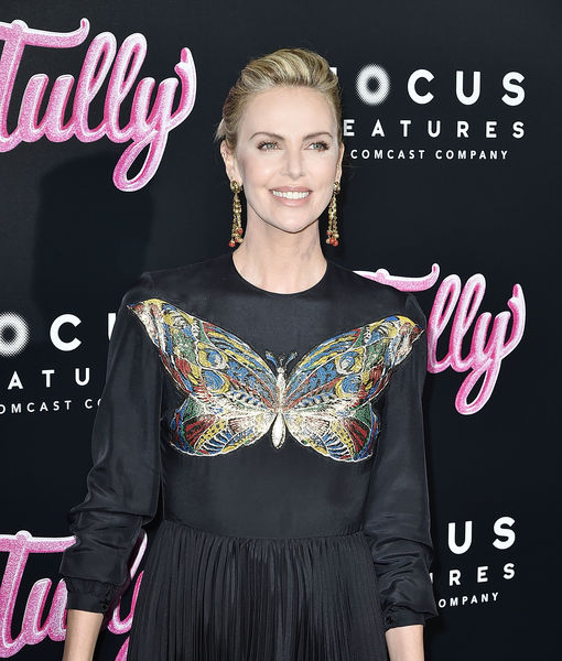 Why Charlize Theron Loves Dressing Up