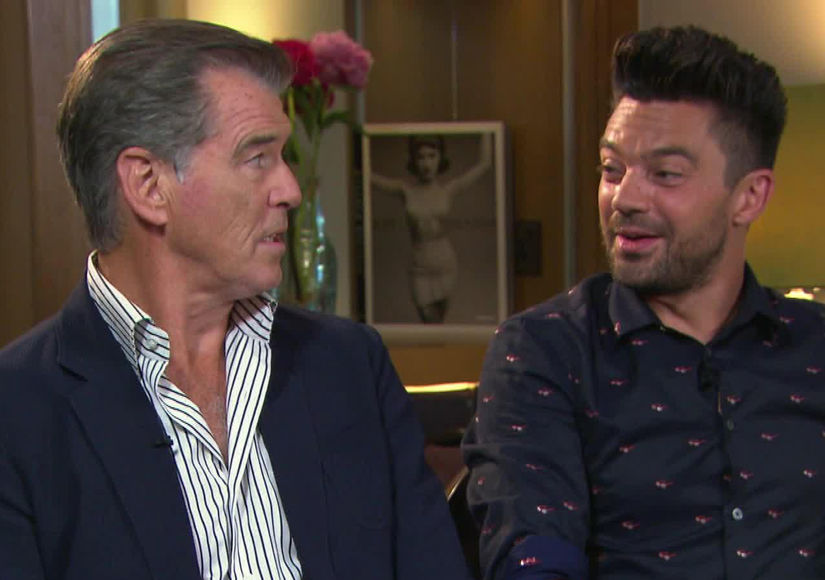 Watch Pierce Brosnan & Dominic Cooper's 'Extra' Bromance