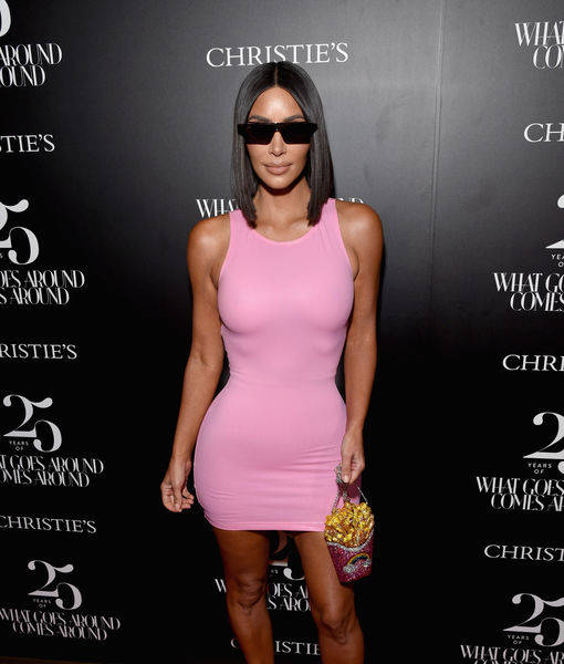 Kim Kardashian Suffers Wardrobe Malfunction in Pink Minidress