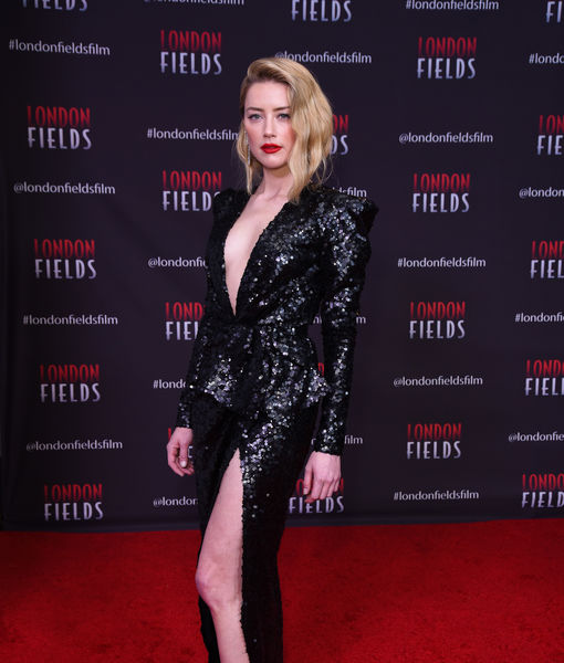 New Couple Alert? Amber Heard Packs on the PDA with Famed Director