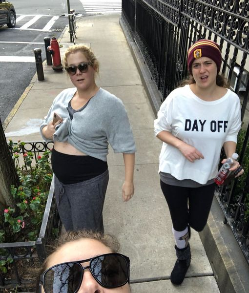 Amy Schumer Flashes Growing Baby Bump – See the Pic!