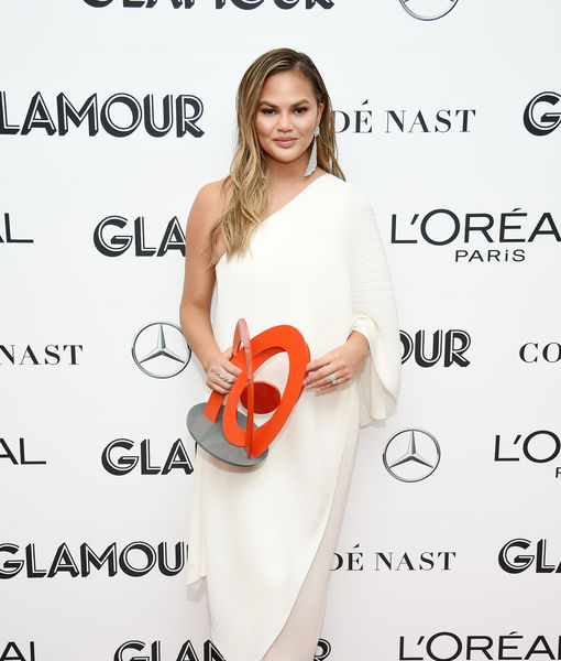 Pic! Chrissy Teigen's Dad Got Her Face Tattooed on His Arm