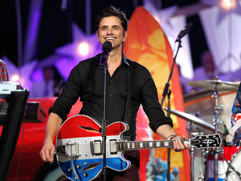 Oops! John Stamos Suffers Wardrobe Malfunction While Performing Live