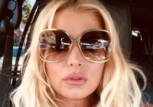 Jessica Simpson Shares 'Joy of Postpartum' as She Stretches in Rubber Corset