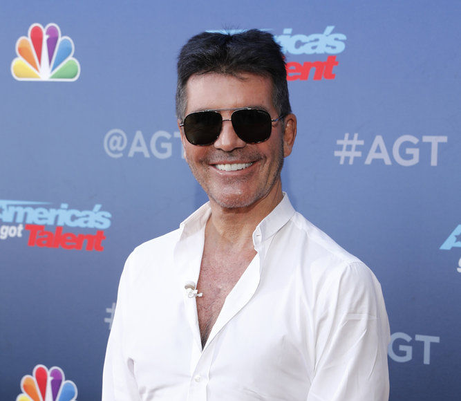 Simon Cowell Breaks Back Testing Bike, Undergoes Surgery