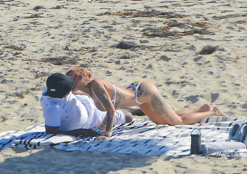 New Couple Alert? Diddy & Tina Louise Spotted Kissing on Beach Date
