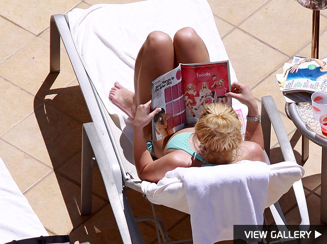 Britney relaxes by the pool