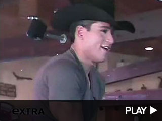 Mario Lopez and Ty Murray ride a mechanical bull.