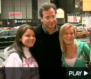 Bob Saget takes a picture with fans in New York City