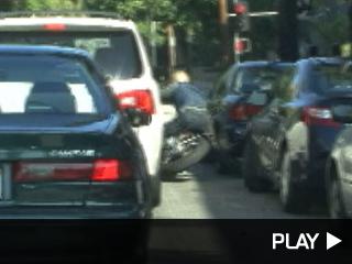 Brad Pitt falling off his motorcycle