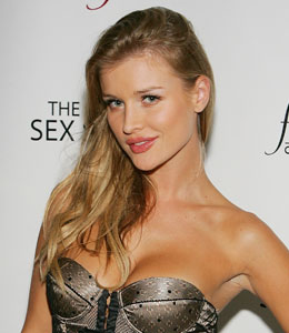 Naked Joanna Krupa covers up with a cross for PETA