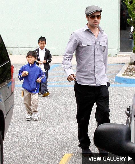 brad pitt takes sons to the movies